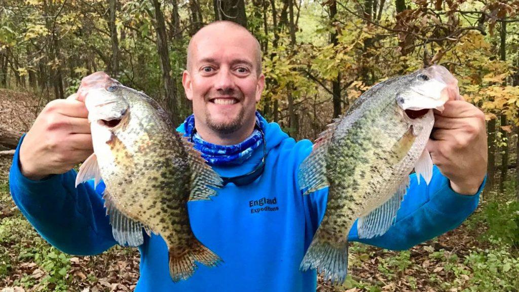 Matt England Holding 2 Fish